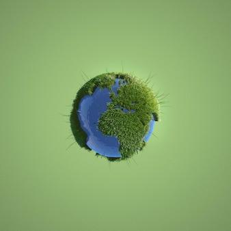 緑の背景に地球のミニチュア