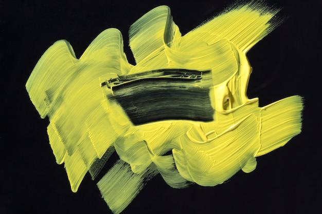 黄色のブラシストロークの抽象芸術