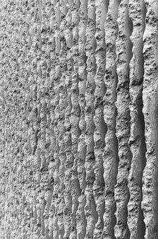抽象的な黒と白のコンクリートセメント建築建築垂直要素テクスチャパターン