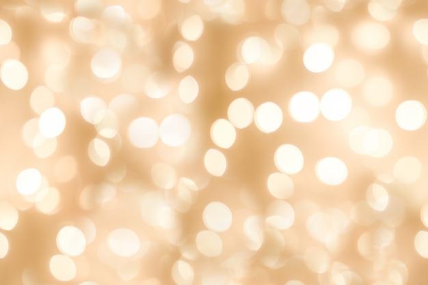 Бесшовные из красивых абстрактных оранжевого блеска света с фоном праздник