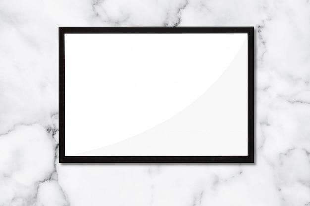 大理石の背景にある黒いフレーム。広告とアートワーク。