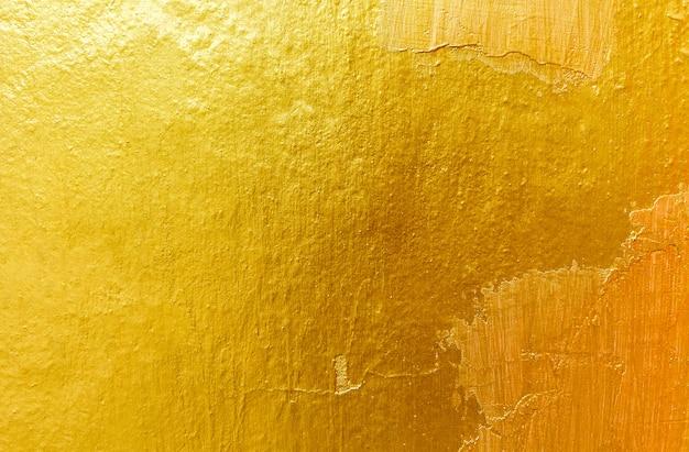 ゴールドの背景色またはテクスチャとグラデーションの影。