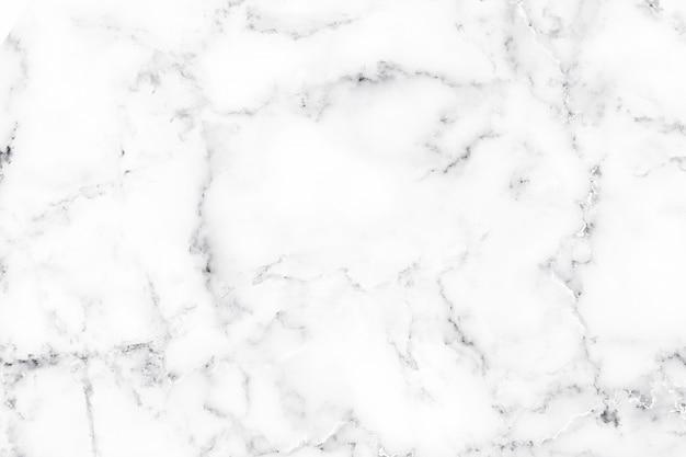 白い大理石の質感と装飾的なデザインパターンアート作品の背景の贅沢。高解像度の大理石