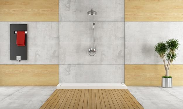 シャワー付きのシンプルなバスルーム