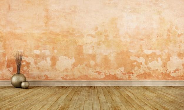 Гранж пустая комната со старой оранжевой стеной и грязным деревянным полом