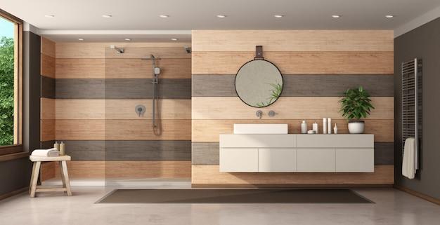 シャワーと洗面台付きのモダンな木製バスルーム