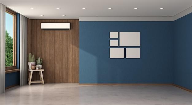 エアコン付きの空の青い部屋
