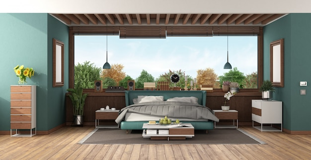 緑のダブルベッドと大きな窓付きの豪華なベッドルーム
