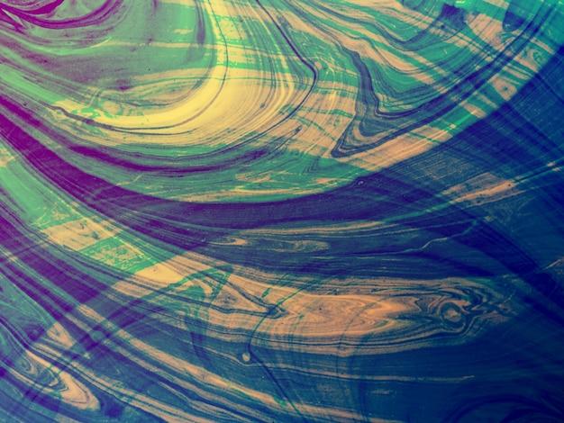 バックグラウンドのアクリルミキシングの渦巻きと動きのカラフルな抽象的な