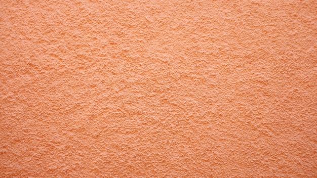 オレンジ色の壁のテクスチャ