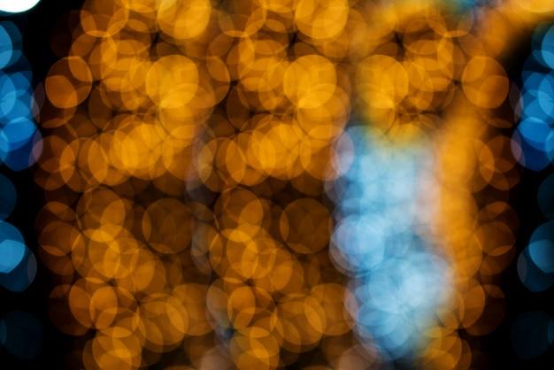 ボケ円、クリスマスの背景の美しい抽象的な色