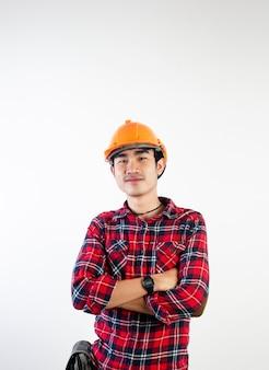 Молодой инженер, который полон решимости успешно выполнять свою работу. фотографии для вашего бизнеса