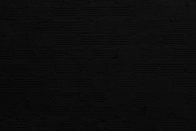 黒い砂利の壁