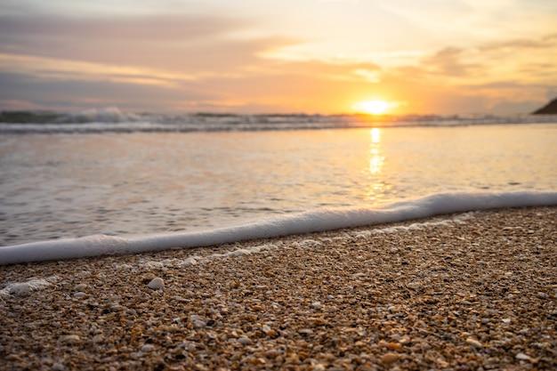黄色の暖かい砂と夏の海と空とコピースペース