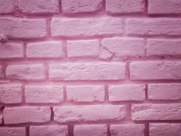 ピンクの石の背景の壁