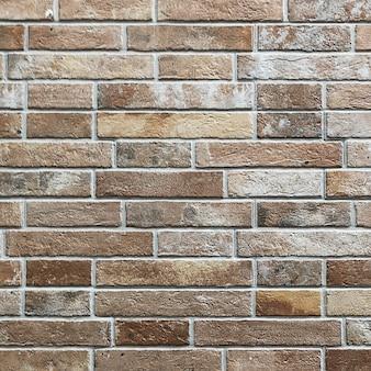 古いダークレッドブラウントーンのレンガの壁のテクスチャ