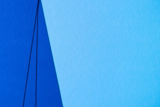 青いテクスチャ板紙組成の抽象的な背景