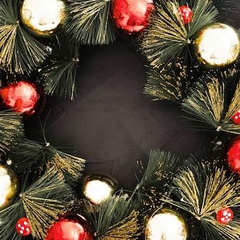 黒のテクスチャ背景にクリスマスボール