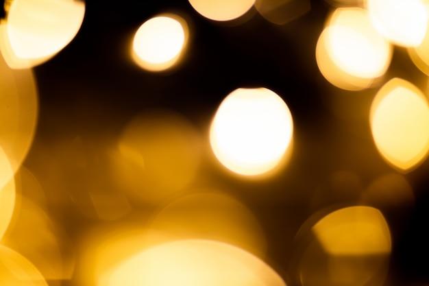 黒の背景のボケ味のライト