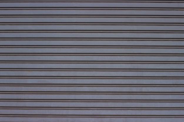 ローラーシャッタードアの金属の質感、ドアガレージ、工場。