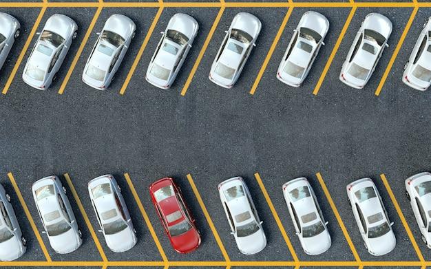 白い車の中に赤い車を駐車。駐車場の車