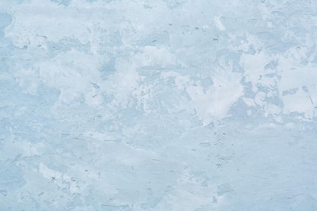 青い荒いコンクリートの壁や抽象的な石膏の斑点のあるテクスチャ