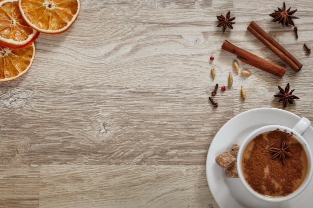 Масала чай в белой чашке со специями