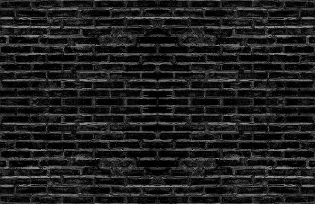 ダークトーンのビンテージインテリアデザインの汚れた古い黒レンガの質感のある壁。