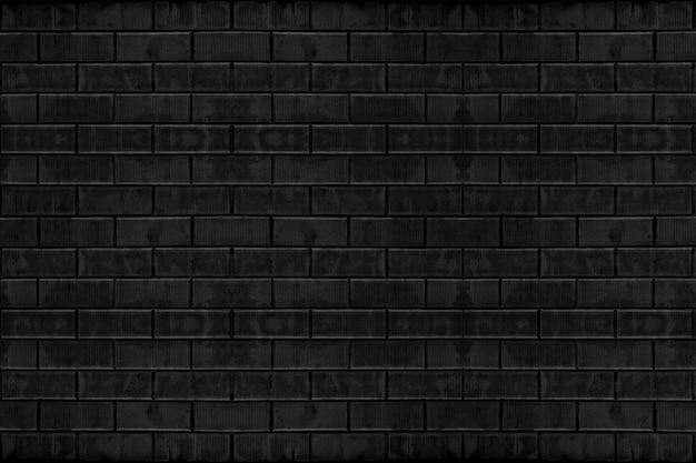 風化した古い暗い黒いセメントレンガブロック壁テクスチャ表面の背景。