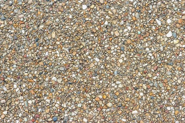 小さなランダム色の石の表面テクスチャ道路の背景