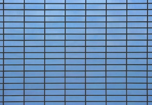 石積みの長方形の青いレンガタイル表面テクスチャデザイン壁の背景。