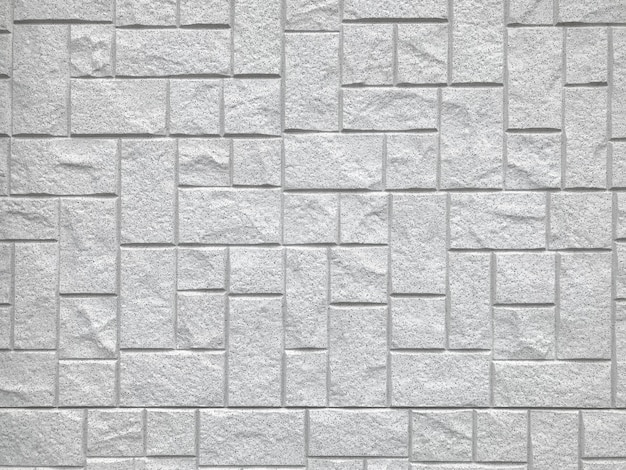 Случайная квадратная каменная предпосылка стены блока кирпича.