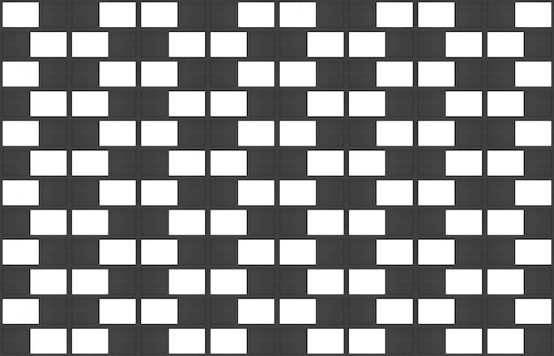 モダンなシームレスな白と黒のレンガブロック壁テクスチャデザインの背景。