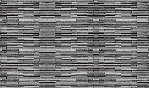 ランダム風化古いダークブラックセメントレンガブロックスタック壁テクスチャ表面の背景。