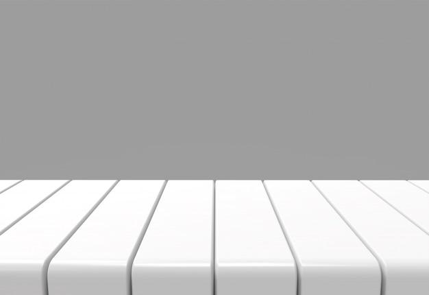 灰色の壁の背景を持つ空の白いパネルテーブル