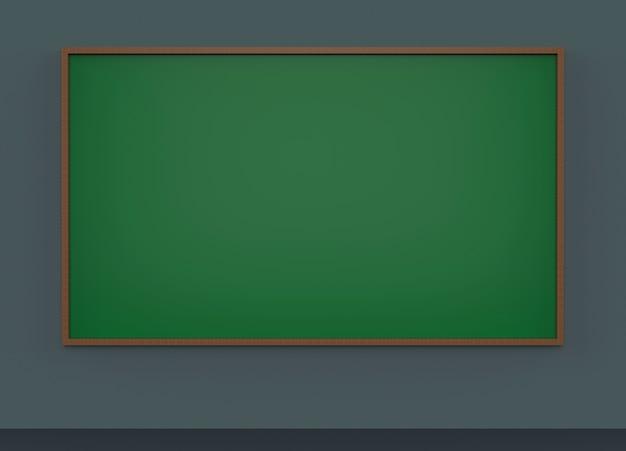 暗い灰色の壁の背景に空の緑色の黒板