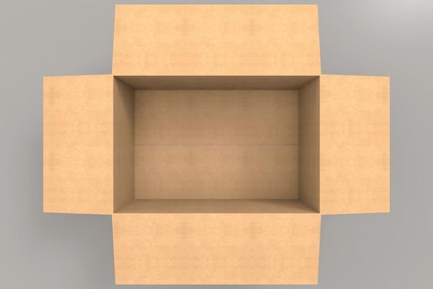 灰色の背景に空の茶色の紙箱の航空写真。