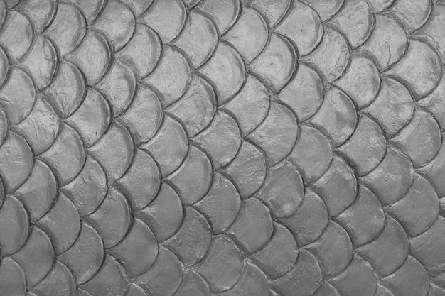 灰色のセメント石膏の魚の皮膚曲線パターンの壁の背景。