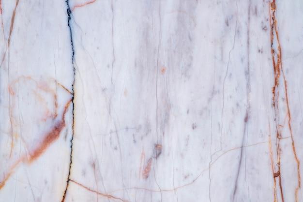 スクラッチ自然な風合いの床の背景を持つダークグレーの大理石