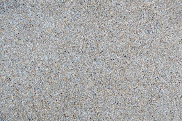 解体された骨材仕上げのコンクリートの壁と床の背景テクスチャ。