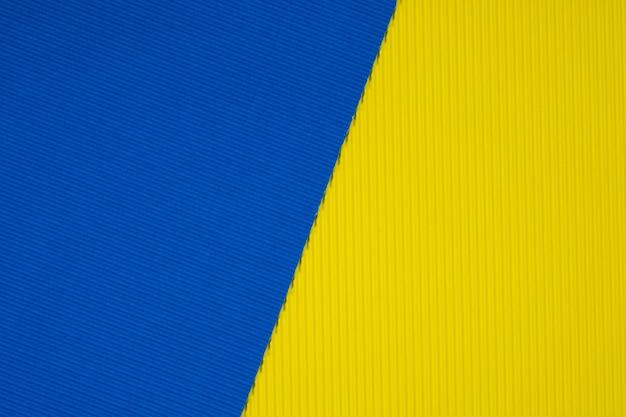 青と黄色の段ボール紙のテクスチャ背景。