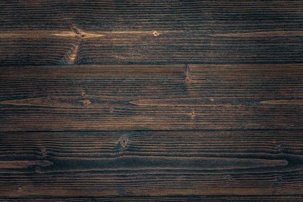 自然な縞模様の背景を持つ暗い茶色木目テクスチャ