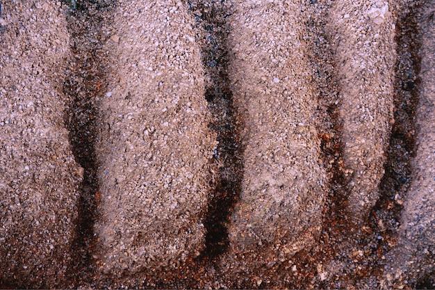 ひびの入った地球土壌地面テクスチャ背景。