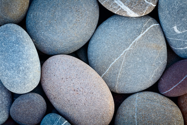 乾燥した丸い小石石マクロの背景