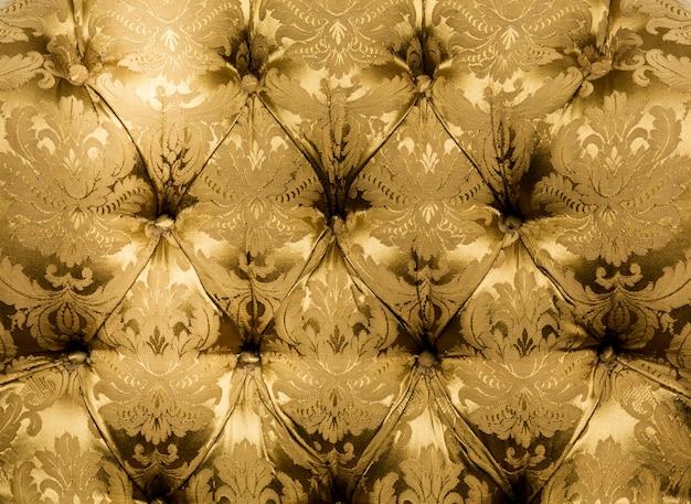 テクスチャヴィンテージマスタード色の美しい素材、質感。クローズアップ、ボタン素材