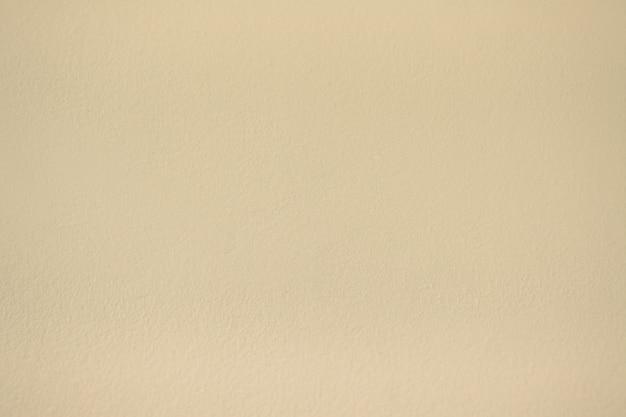 柔らかい茶色の色のコンクリートの壁のペンキの質感の抽象的な背景