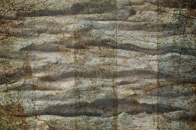 グランジの茶色と青の亀裂壁のテクスチャ