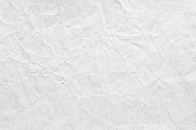 古い灰色の紙を丸めて背景テクスチャ