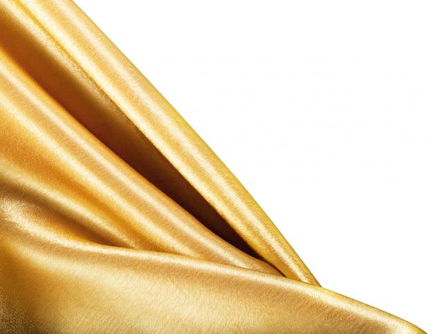 白で隔離される黄金の布