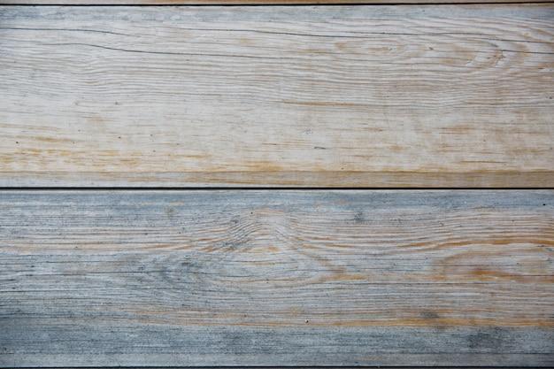 自然なパターンを持つ水平ウッドテクスチャ背景の表面。素朴な木製のテーブルまたは床の上面図。